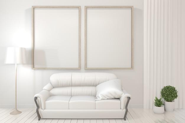 Poster interni cornici in legno, divano, pianta e lampada in soggiorno con design minimal parete bianca.