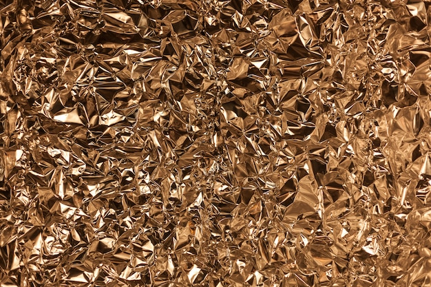 Presa completa del fotogramma di un foglio di foglio di alluminio dorato stropicciato