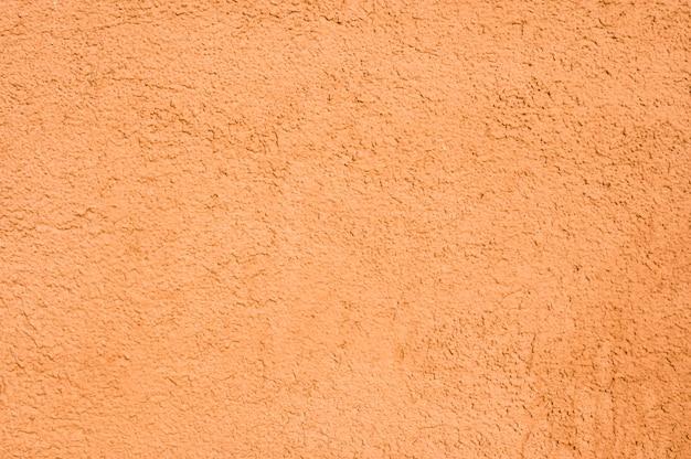Primo piano arancione della parete della casa