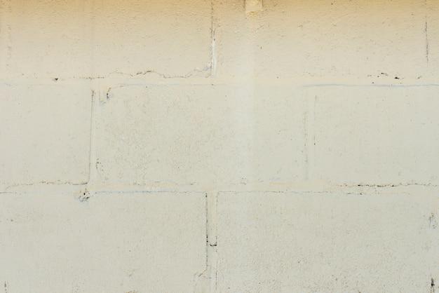 Primo piano del fondo bianco del muro di mattoni