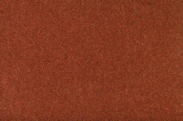 Primo piano del tessuto scamosciato opaco arancione scuro