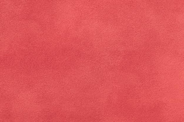 Primo piano del tessuto scamosciato opaco rosso scuro