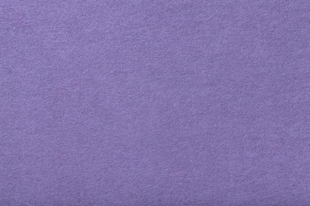 Primo piano del tessuto scamosciato opaco viola chiaro.