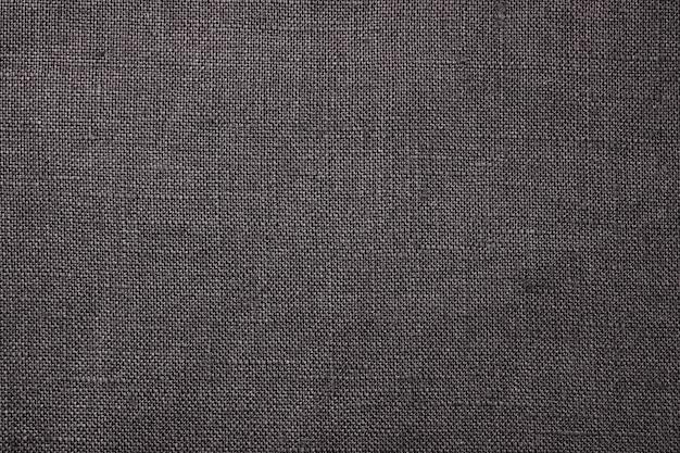 Primo piano del tessuto. trama di lino grigio