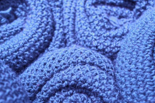 Primo piano del tessuto tricottato di lana d'avanguardia di colore del mare di sargasso, struttura, fondo