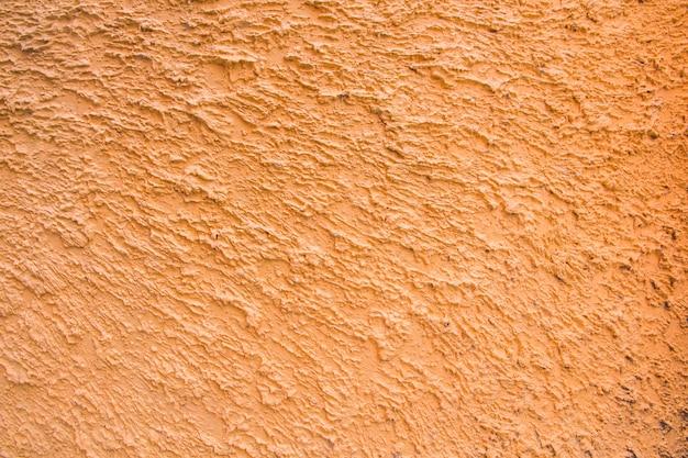 Primo piano dell'arancia dello stucco del cemento