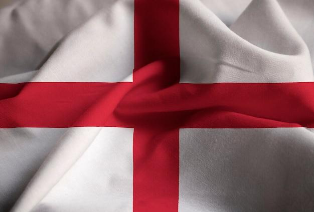 Primo piano della bandiera arruffata dell'inghilterra, bandiera dell'inghilterra che soffia in vento
