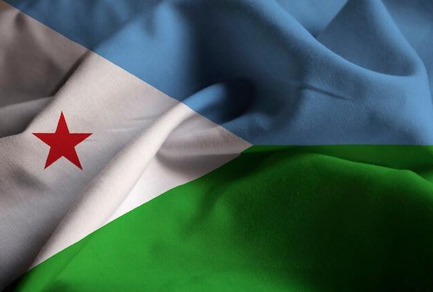 Primo piano della bandiera arruffata di gibuti, bandiera di gibuti che soffia nel vento