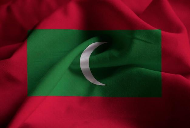 Primo piano della bandiera increspata delle maldive, bandiera delle maldive che soffia in vento