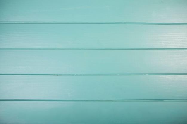 Primo piano della plancia di legno colorata turchese