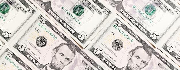 Primo piano di banconote da un dollaro come sfondo
