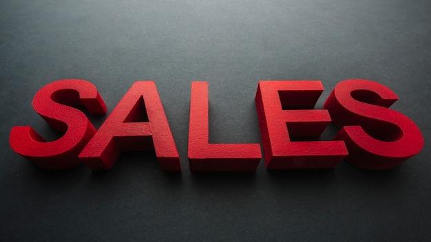 Primo piano di concetto di vendite di colore rosso