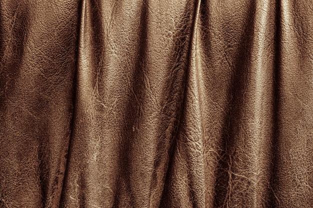 Primo piano di struttura in pelle marrone. colore di sfondo in pelle per la progettazione del lavoro e grafica.