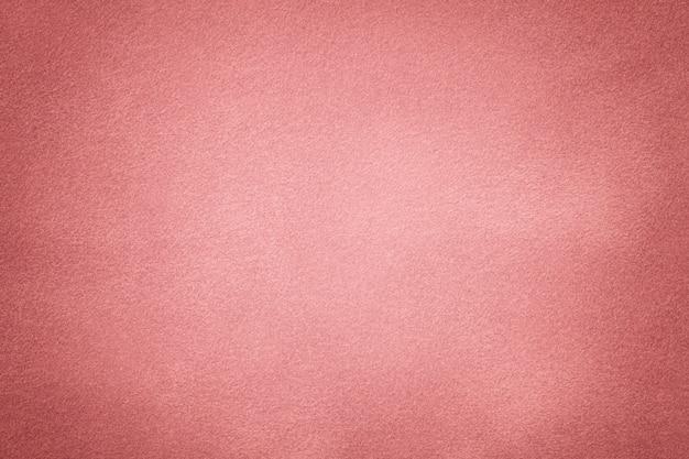 Primo piano di tessuto rosa scamosciato opaco.