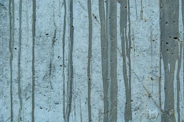 Primo piano di una parete rustica grungy esposta all'aria con i punti della pittura e vecchio cemento - carta da parati perfetta di lerciume