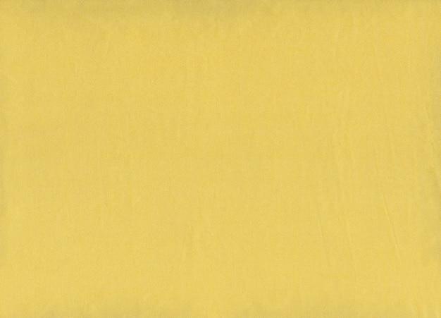 Primo piano dorato di struttura del tessuto