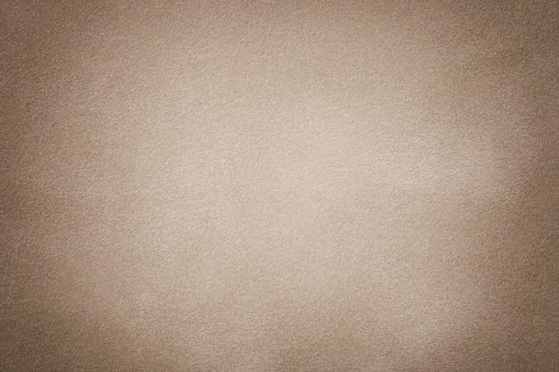 Primo piano in tessuto scamosciato marrone chiaro opaco.