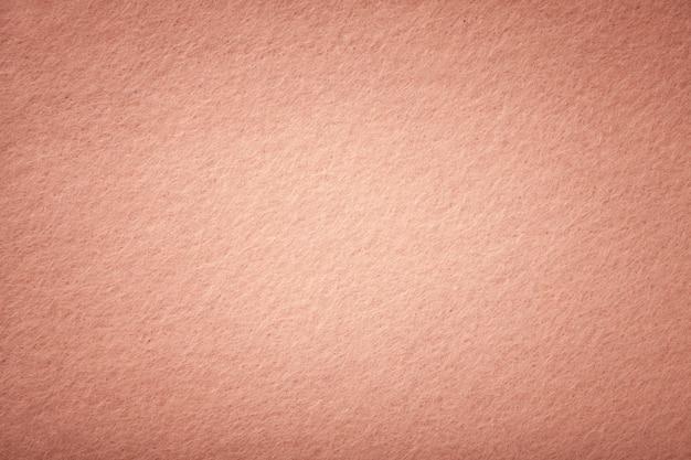 Primo piano in tessuto scamosciato opaco oro rosa.