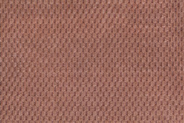 Primo piano lanoso morbido del tessuto di marrone scuro