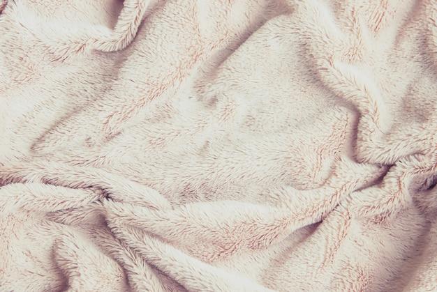 Primo piano lavorato a maglia coperta coperta plaid. messa a fuoco selettiva.