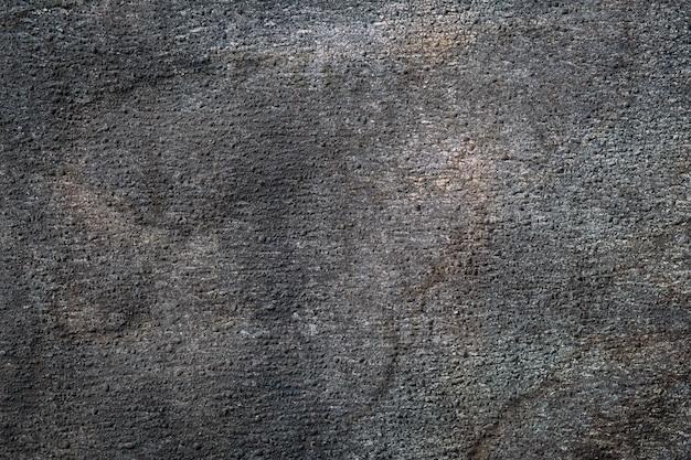 Primo piano materiale del tetto di struttura abrasiva. astratto sfondo granulare scuro.