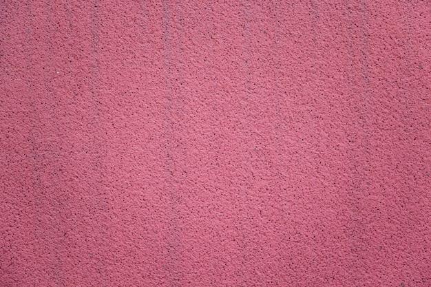 Primo piano rosa luminoso della parete dello stucco