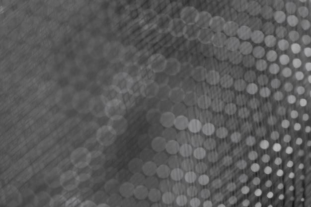 Primo piano scuro lucido della maglia metallica
