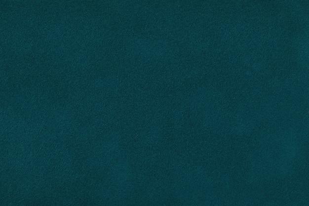 Primo piano verde scuro del tessuto scamosciato opaco. velluto texture di sfondo.