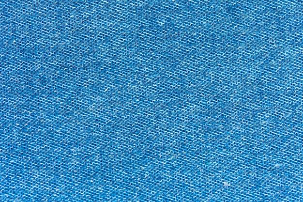 Priorità bassa a macroistruzione di struttura dei jeans del denim.
