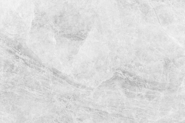 Priorità bassa astratta da struttura di marmo bianca con luce solare.
