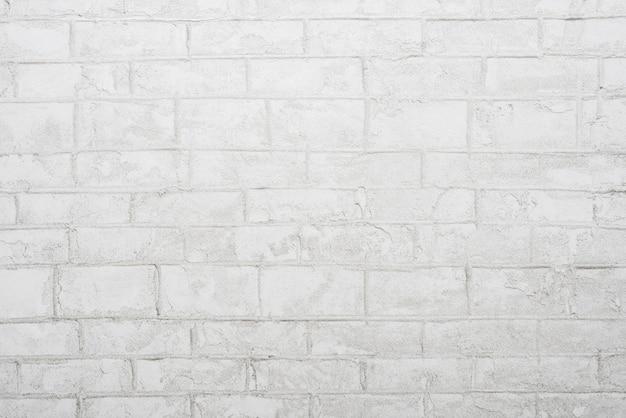 Priorità bassa astratta dal muro di cemento grigio con luce.
