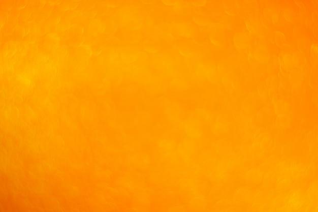 Priorità bassa astratta dell'arancio del cerchio di bokeh