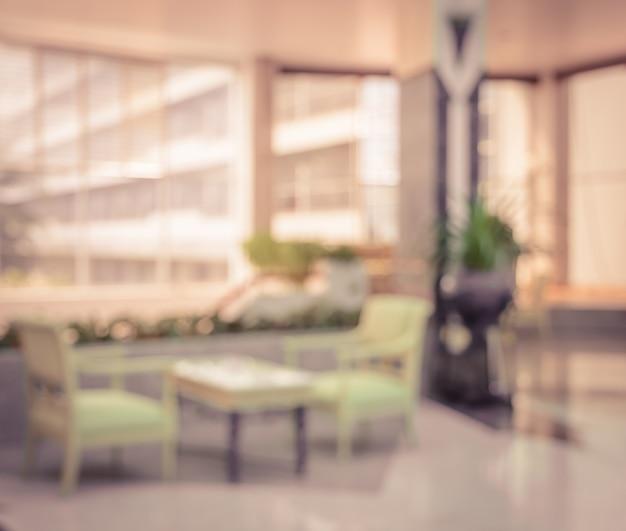 Priorità bassa astratta della sfuocatura dell'ingresso dell'hotel nell'effetto d'annata