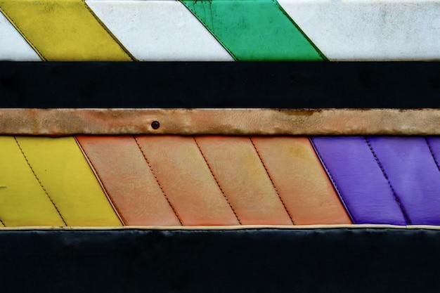 Priorità bassa astratta di cuoio di vecchia struttura gialla, verde, viola e bianca variopinta