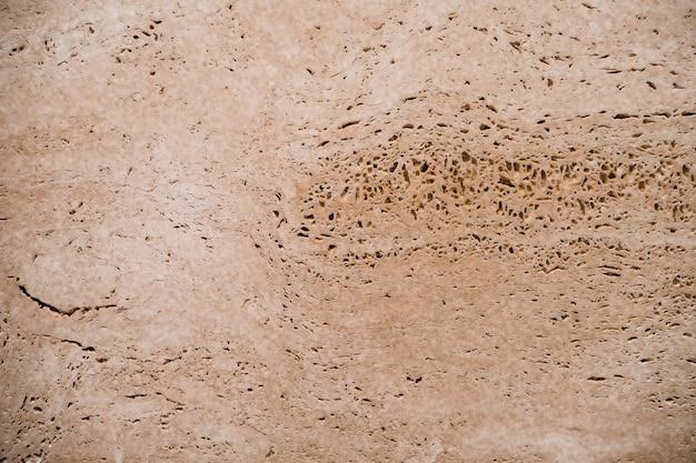 Priorità bassa astratta, struttura porosa marrone, pietra della natura