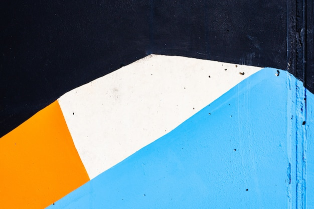 Priorità bassa astratta verniciata su una parete con i colori bianchi e blu.