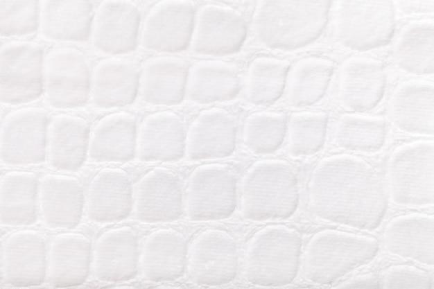 Priorità bassa bianca dal tessuto morbido della tappezzeria, primo piano