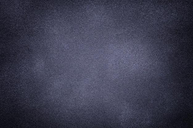 Priorità bassa del primo piano grigio scuro e blu del tessuto della pelle scamosciata.