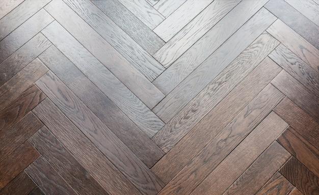 Priorità bassa del reticolo di pavimento in legno a spina di pesce a zig-zag