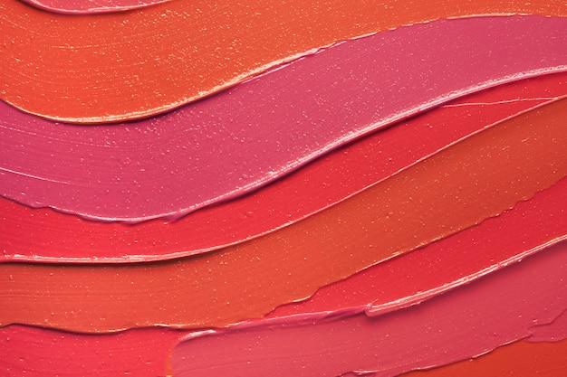 Priorità bassa del rossetto spalmata arancione viola rosso