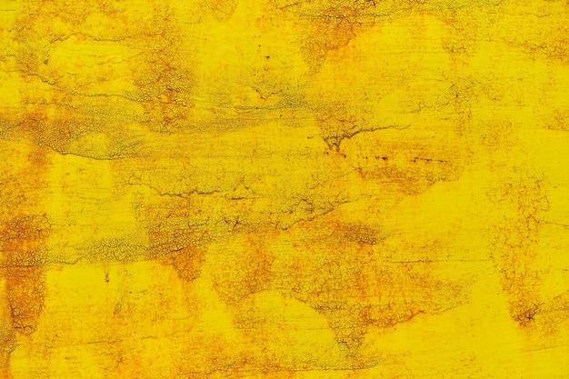 Priorità bassa dell'acquerello nella vecchia vernice gialla vintage
