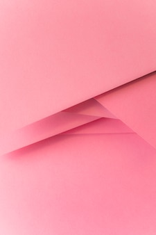 Priorità bassa della bandiera di carta colorata pastello rosa