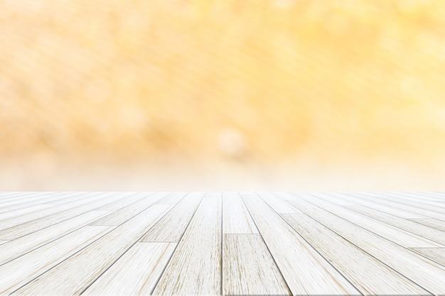 Priorità bassa di bokeh con pavimento in legno