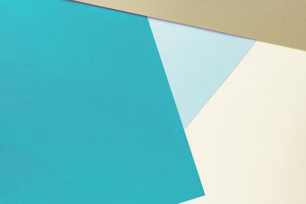 Priorità bassa di carta geometrica astratta dei colori marrone, blu e beige pastelli