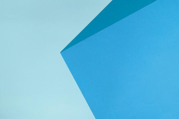 Priorità bassa di carta geometrica astratta nei colori blu.