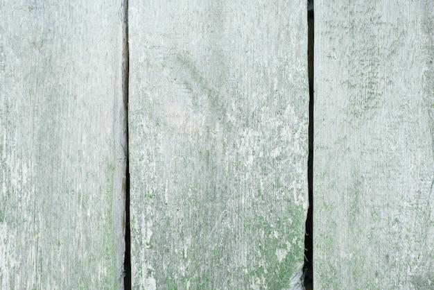Priorità bassa di legno della plancia della sbucciatura verde sporca
