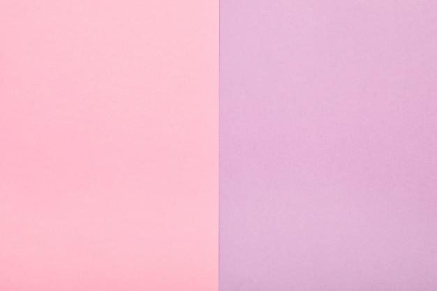Priorità bassa di minimalismo di struttura di carta colorata pastello. fogli di carta rosa e lilla.
