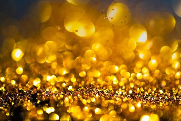 Priorità bassa di scintillio luci oro di grunge