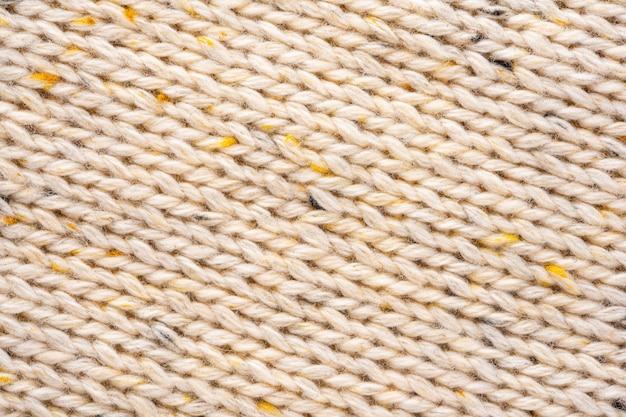 Priorità bassa di struttura del maglione lavorato a maglia della lana