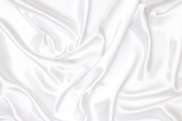 Priorità bassa di struttura del tessuto bianco. liscio elegante seta bianca può utilizzare come sfondo del matrimonio.